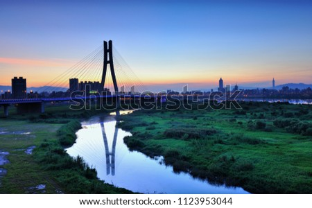 Taiwan, New Taipei City, the beautiful twists and turns of the river, reflecting the sky, bridges, sunrise and sunset city beautiful scenery. #1123953044