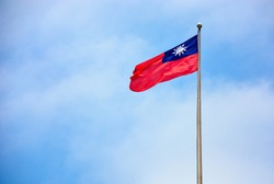 Taiwan (Republic of China) flag at liberty square, Chiang Kai-Shek Memorial Hall waving in the wind on the mast with blue sky and clouds background, copy space, clipping path