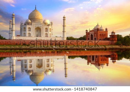 Taj Mahal Agra at sunset with water reflection and moody sky #1418740847