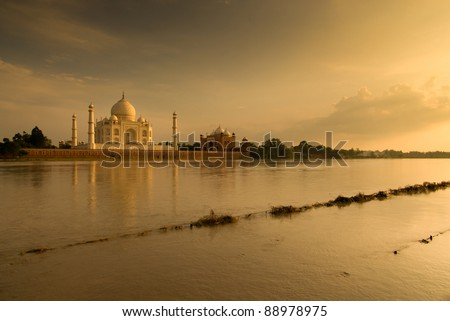 Taj Mahal, Agra, India. Romantic picture taken in sunset scene on  other side of river.