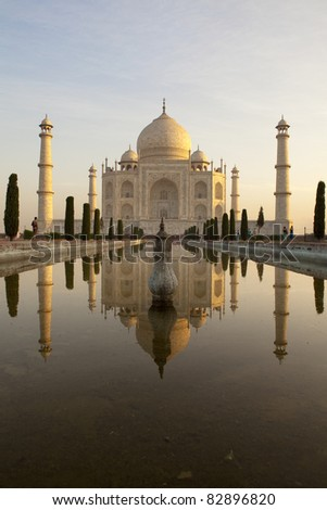 Taj Mahal at sunrise reflecting in the pond.