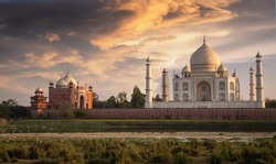 Taj Mahal at sunset as seen from Mehtab Bagh on the banks of the river Yamuna at Agra. Taj Mahal designated as a World Heritage Site is a masterpiece of Indian heritage and architecture.