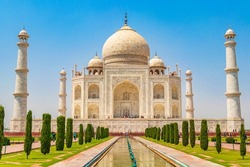 Taj Mahal in Agra India Mogul marble mausoleum and panorama of the famous 17th century symmetrical gardens.