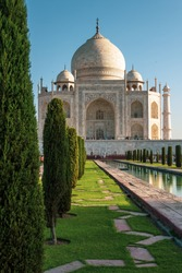 Tajmahal in morning light with garden trees and water fountain