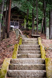 Takayama, Japan wooden temple shinto shrine point of view from steps stairs in Hida no Sato old folk village in Gifu prefecture