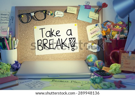 Take a break note on bulletin board in office / Overloaded worker needs break or day off concept