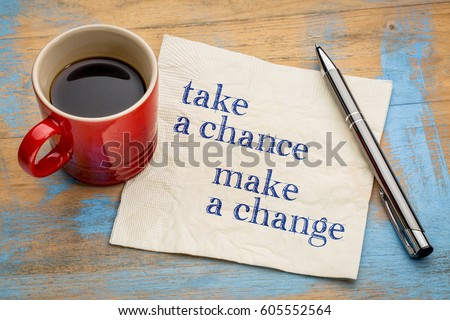 Take a chance, make a change - inspirational handwriting on a napkin with a cup of espresso coffee
