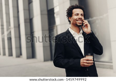 Take a pause. Waist up portrait of smiling businessman talking on smartphone while having coffee break on office #1459749992