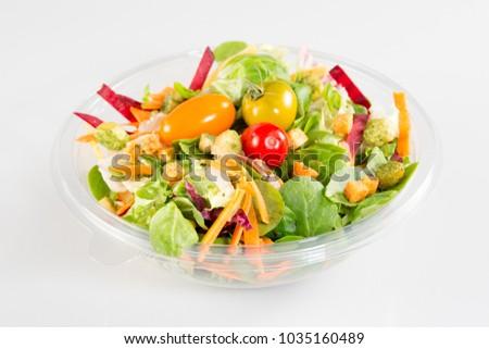 Take away salad on white background #1035160489