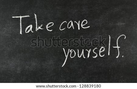 Take care yourself written on blackboard