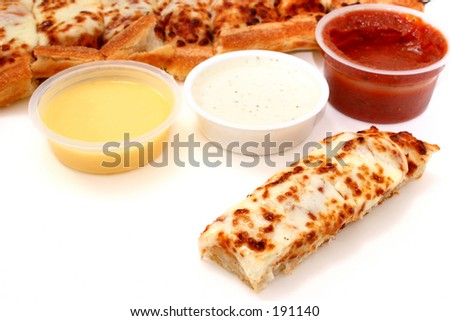 Take cheese pizza sticks with a container of marinara sauce, ranch dressing and garlic butter.