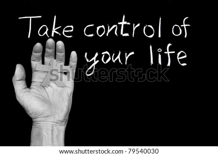 Take control of your life. Words and human hand  on blackboard.