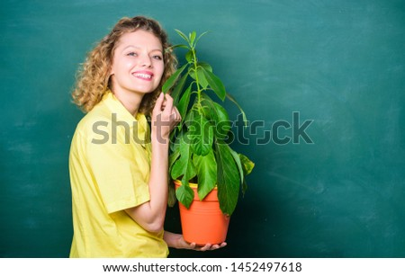 Take good care plants. Girl hold plant in pot. Plants that sure stress relief home and provide you with sanctuary of peace and tranquility. Florist concept. Botany is about plants flowers and herbs. #1452497618