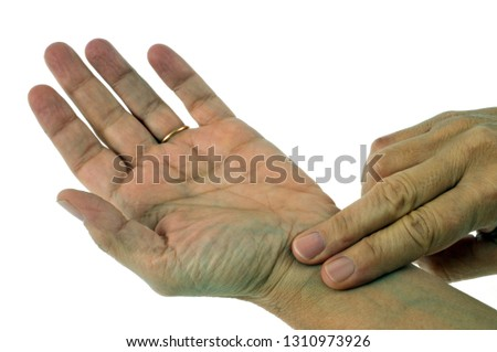 Take the pulse on your wrist on white background Foto stock ©