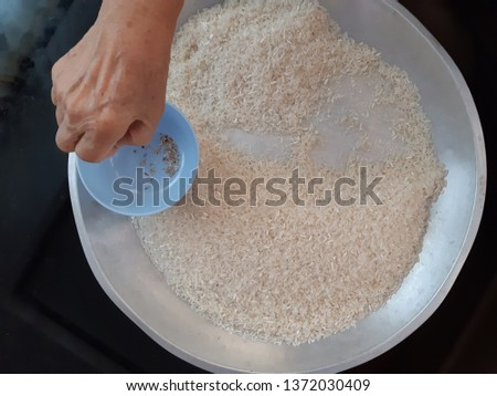 take weeds out of rice grains ckncept background #1372030409