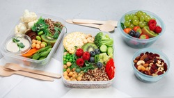 Takeaway  lunch boxes with homemade nutrition food. Organic vegan meals.