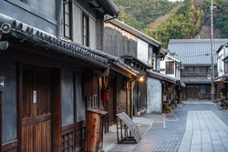 Takehara Townscape Conservation Area in dusk. The streets lined with old buildings from Edo, Meiji periods, a popular tourist attractions in Takehara city, Hiroshima Prefecture, Japan