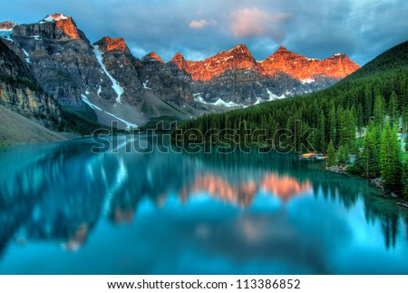 Stock Photo Taken at the peak of color during the morning sunrise at Moraine lake in Banff National park.