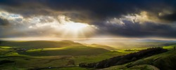 Taken from Mam tor in the Peak District National Park, the landscape had been subject to stormy weather all day, until the beams of light had managed to pass through the dark clouds.