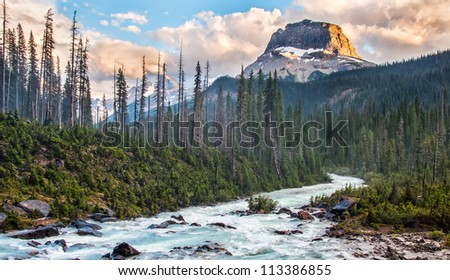 Taken in Yoho National park just as the setting sun lit the one side of this rockey peak.