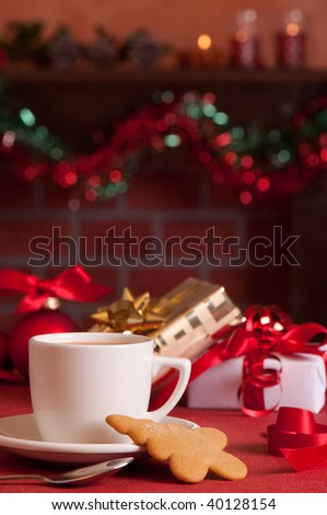 Taking a break from Christmas present wrapping with a cup of tea and cookie