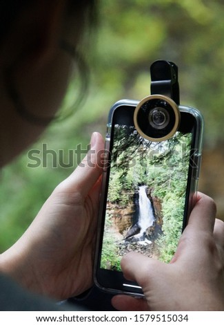 Taking a photo of waterfall