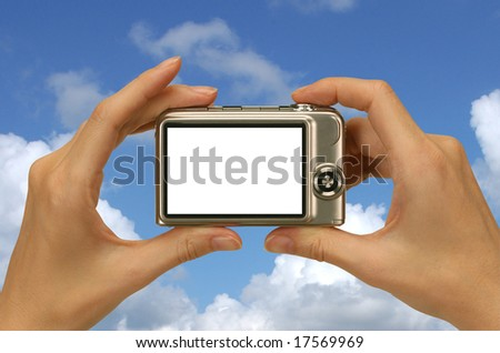taking a photograph against a sunny blue sky