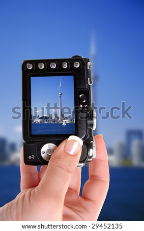 taking a picture of the CN Tower in Toronto, Ontario, Canada