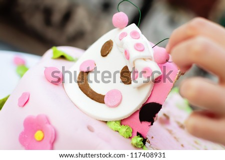 Taking a piece of child's birthday cake