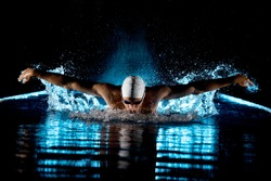 Taking breath swimming butterfly isolated black background