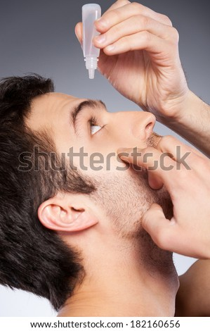 Taking Care Of His Eyes. Side View Of Young Man Applying ...