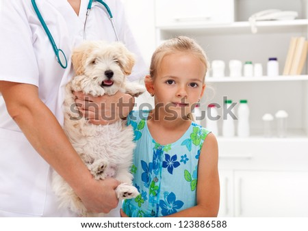Taking my doggy to the veterinary - child with her pet