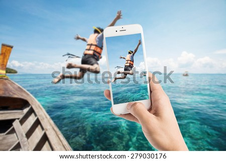 Taking photo of snorkeling divers jump in the water  #279030176