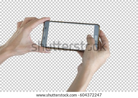 Taking photo with mobile smart phone isolated on transparent background with clipping path for the screen.