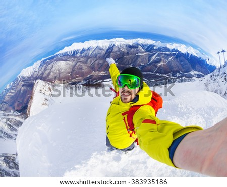 Taking selfie standing on top of the mountain