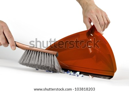 taking the dirt with brush and dustpan - stock photo