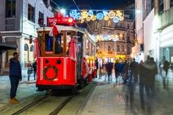 Taksim, Istiklal Street, Istanbul. Turkey. Nostalgic Red Tram in Taksim Istiklal Street at evening.