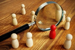 Talent acquisition and management. Magnifying glass and gavel.