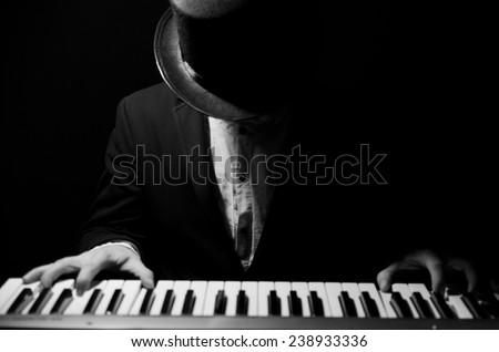 Talent and virtuosity. Black and white top view image of man playing piano