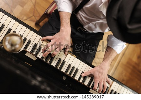 Talent and virtuosity Top view of handsome young men playing piano
