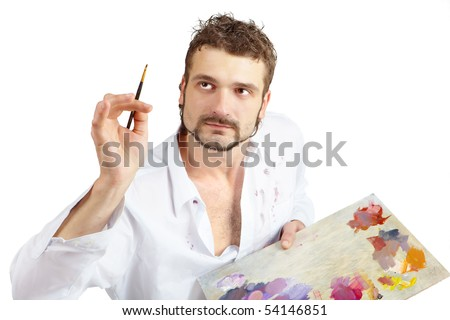 Talented artist with brush and palette in action. Isolated over white