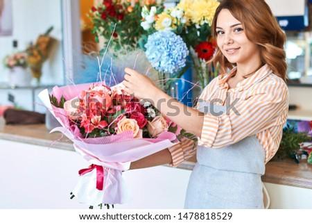 talented florist has prepared wonderful bouquet for client. close up portrait.lifestyle, spre time, free time