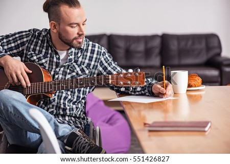 Shutterstock Talented handicapped guy writing song lyrics