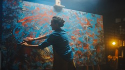 Talented Innovative Female Artist Draws with Her Hands on the Large Canvas, Using Fingers She Creates Colorful, Emotional, Sensual Oil Painting. Contemporary Painter Creating Abstract Modern Art.