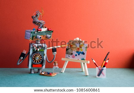 Talented robot artist paints an abstract picture with watercolors. Wooden easel and artist's tools palette, pencils case. Advertising poster studio school of visual arts interior.