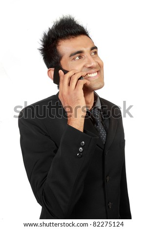 Talking business over the phone and smiling
