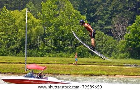 TALKING ROCK, GA/USA - JUNE 19: Unidentified man ski jumping during a  competition, June 19, 2011 in Talking Rock, GA at the  Whitestone Summer Starter Tournament. - stock photo