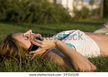 talking woman on grass