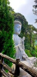 Tall and big statue of buddha on the mountain
