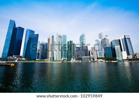 Tall and modern skyscrapers in business district of the city of Singapore.